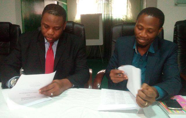 Mr. Chinedu Chukwuji, General Manager,COSON and Mr. Segun Jerome, Managing Director of PlaySpread Ltd. sign music airplay monitoring agreement in the COSON Office recently.