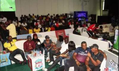 Nigerians Watching Football
