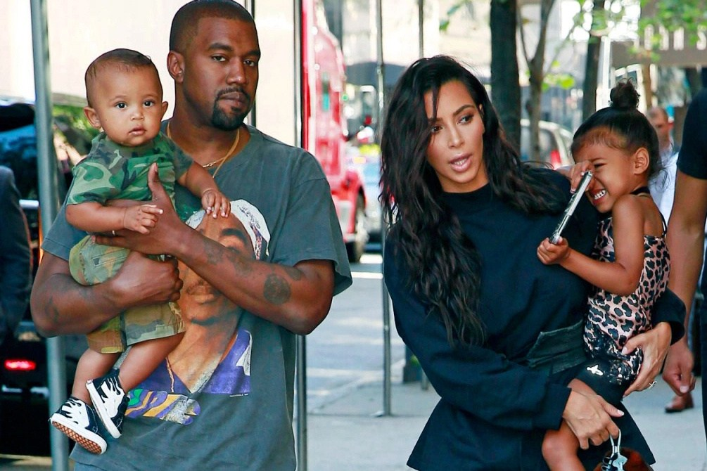 Kanye West and Kim with their Children